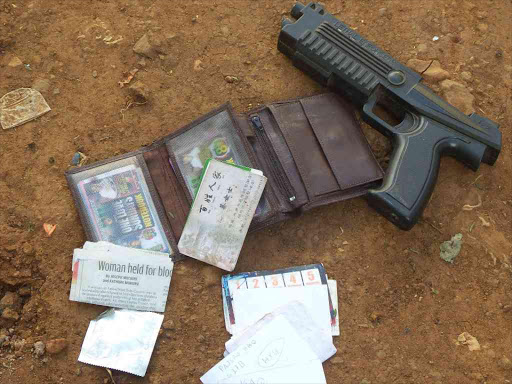 Some of the items found by police after suspected thugs were shot dead in Kawangware, Nairobi, March 22, 2015. /COLLINS KWEYU