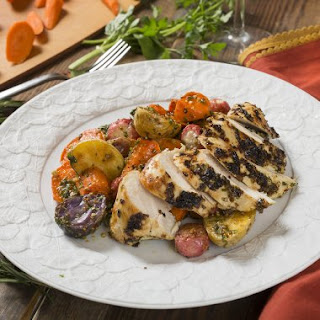 Herbed Chicken Breasts atop Winter Root Vegetable Salad