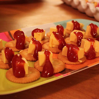 Velveeta and Ketchup on Ritz Crackers