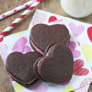 Chocolate Heart Sandwich Cookies with Raspberry Cream Cheese Filling.