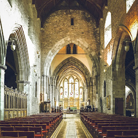Cathedral by Jennifer  Loper  - Buildings & Architecture Places of Worship ( stained glass, chairs, lighting, worship, crucifix )