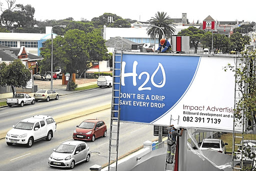 Urgent action needed: A private billboard in Port Elizabeth calls for the saving of water. SA is the 30th most dry country in the world and limited water stocks may hit companies' bottom lines. Picture: THE HERALD