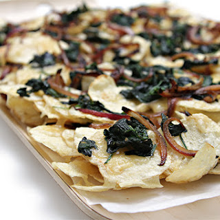 """Potato """"nachos"""" With Smoked Raclette, Wilted Spinach And Caramelized Red Onion."""
