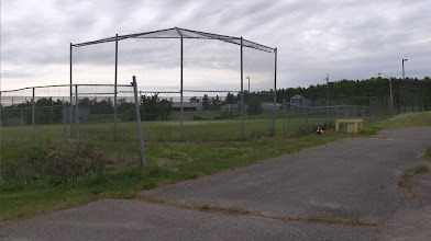 Photo: The baseball diamond is all covered with grass now and the fences have seen better days.