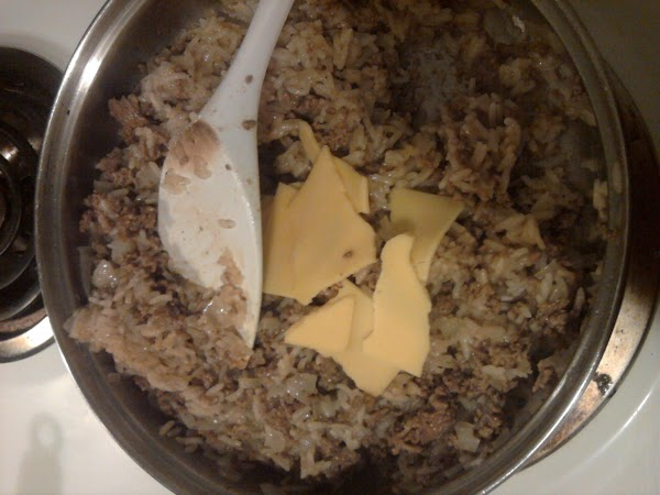 After rice has cooked for 20 minutes add in two slices of cheese and...