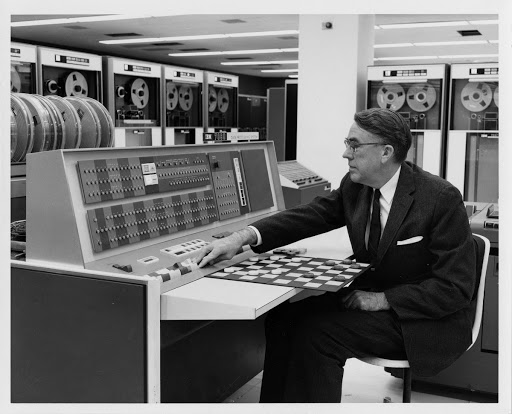 Arthur Samuel demonstrates how machine learning can be used to play checkers in 1962