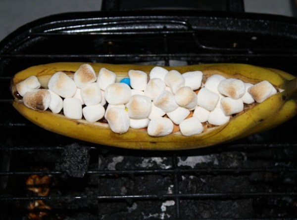 Place on medium grill and cook until chocolate has melted and marshmallows have browned.