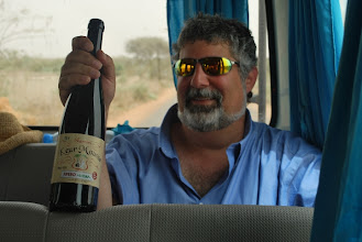 Photo: Dr. Pellegrino on a Faculty Development trip to Senegal 2010 - wine from the Keur Moussa Monastery, confiscated by Senegalese security.