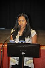 Photo: Maya Ganesan reads her poem.