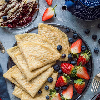 Vegan Crepes With Berry Compote And Chocolate Sauce.