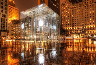 Photo: Empty Apple Store, New York  I always wanted to take a photo from this angle and thought about it ever since the first time I visited. I was happy with the rain, because it made it all feel right. Even better, I was standing under an arch so I was perfectly dry... these kind of shots out in the rain with the 14-24 are tough because of the bulbous lens. It's not a problem if the rain is straight down, but it never is!  from the blog at www.stuckincustoms.com