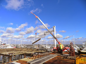 Photo: Lifting another wooden joist in to position - at last a picture taken on a nice sunny day during February!