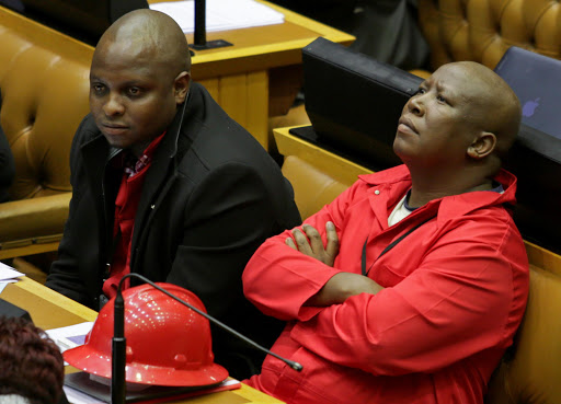 EFF leader Julius Malema in the National Assembly during a debate on President Jacob Zuma's state of the nation address in Parliament