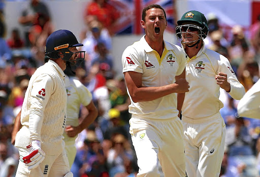 Early strike: Fast bowler Josh Hazlewood, centre, celebrates after claiming the wicket of England's Mark Stoneman. Picture: REUTERS
