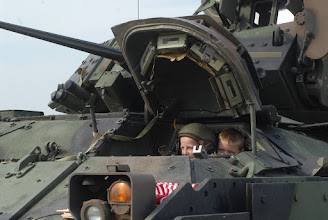 Photo: Children check out the view from a Bradley Fighting Vehicle.