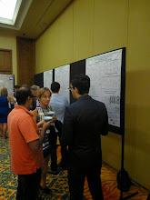 Photo: Evan talking with Ramesh and Prof. Marina Petrukhina(Photo Credit: Fusion Conferences)