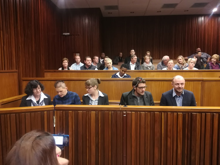 The Krugersdorp murder accused in the dock are, from left to right, Marinda Steyn, Cecilia Steyn (no relation), Marcel and Le Roux Steyn (Marinda's children) and Zak Valentine.