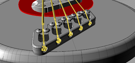 Photo: The bridge side of the strings. They're tapered, and gauged like standard Dingwall SS strings. I've setup the action pretty low, following the radius and with 1mm higher action on the B than on the G string. Since there's no relief in the neck, it doesn't really matter. After all, no one will play it to notice.