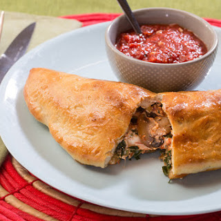 Mushroom & Collard Green Calzones with Fresh Mozzarella & Tomato Dipping Sauce