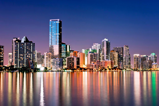 The Miami skyline glitters at night.