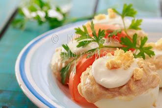 Photo: Deviled eggs with a sprig of parsley and tomato