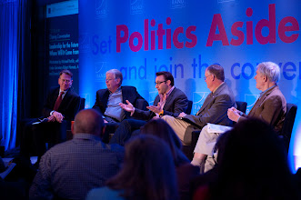 """Photo: Moderator Michael Portillo and panelists Kent Kresa, Admiral James Loy and Under Secretary Robert Hormats listen as Simon Sinek makes a point during the closing conversation, """"Leadership for the Future: Where Will It Come From?"""" Saturday, Nov. 17 at the RAND Politics Aside event in Santa Monica."""