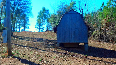 Photo: Secondary water source 500' drilled well and storage building. The home is connected to city water.