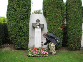 Photo: Wayne places a rose at the grave of the scientist Ludwig Boltzmann.
