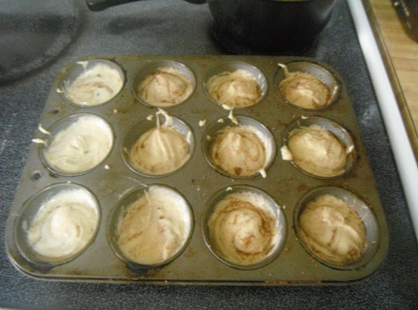 THEN TOP WITH MORE MUFFIN MIX AND TAKE A TOOTHPIC AND PUT IN EACH...