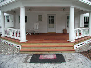 Photo: Mahogany Decking Roman Cobble circle  (Antique Grey) http://northernlightslandscapecontractors.com