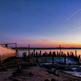Boat at Sunrise by Carol Ward - Transportation Boats ( beached, sinking boat, delaware, sunrise, port mahon, boat, abandoned )