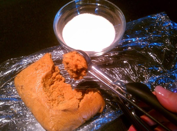 Line large baking sheets with parchment paper. Place decorator sugar for rolling, in a bowl....