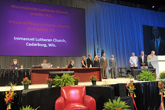 Photo: At the Synod Convention, Dr. Thomas Zehnder (far right at podium), executive director of LCMS World Mission, introduced Mountainside Lutheran Church, Linville, North Carolina, Prince of Peace Lutheran Church, Springfield, Virginia, and First Immanuel Lutheran Church, Cedarburg, Wisconsin, before the Convention. Each congregation received a special recognition award for their participation in the Fan into Flame campaign for new and expanded mission initiatives.