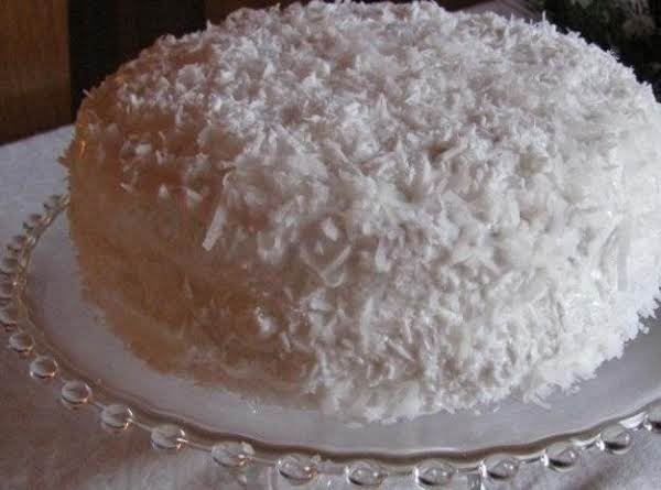 The Angel Food Cake Covered In Flaked Coconut And You Can Use A Round Cardboard Disk To Cover The Hole In The Middle So As Not The Have A Hole.....or You May Have A Better Idea Of How To Hide It.