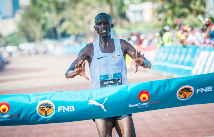Joshua Cheptegei claims gold at the inaugural FNB Durban 10K CITYSURFRUN in 2017.