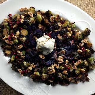 Roasted Brussels Sprouts and Cauliflower with Pomegranate Two Ways and a Za'atar Yogurt Sauce