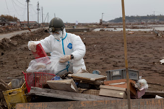 Photo: May 7, 2011. Odaka, Fukushima, Japan. On our way to the ocean one day we come across some members of Japan's Self-Defense Forces engaged in recovery work. The photo albums will be delivered to shelter outside the exclusion zone in the hopes that their owners may recover them.