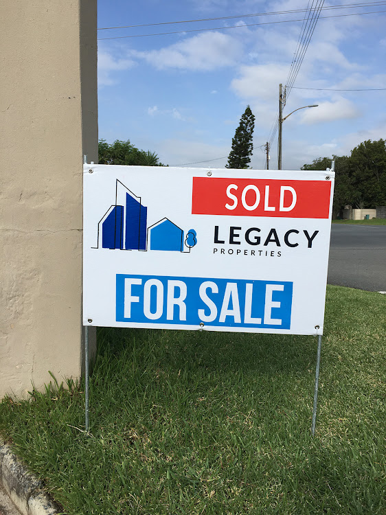 Legacy Properties sign