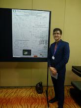Photo: Evan at his poster (Photo Credit: Fusion Conferences)