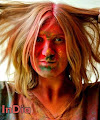 solo female traveler playing holi color festival in india
