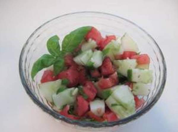 Chop tomatoes & cucumbers, (I peel about 1/2 of the cucumber because the skin...