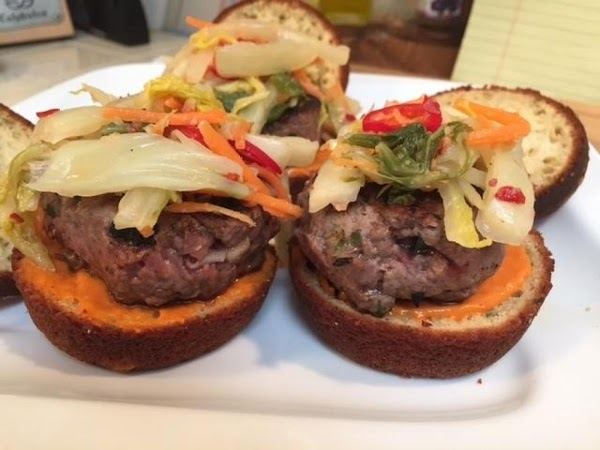 Assembling the sliders: Slice each bun in half and spread about 1 teaspoon of...