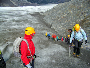 Photo: After a lesson in using the gear, we climb the steep ice to find better footing.