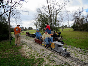 Photo: George Frank and John Frank passed under the water hose held by Steamer Bill Smith and Vance Nickerson     HALS Chili Fest Meet 2014-0301 RPW