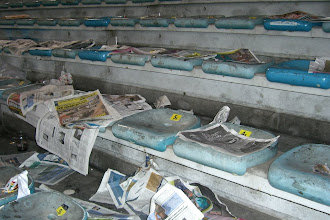 Photo: The seats after the soccer match.  This is typical of what we saw in various parts of Rome.  The citizens there have little respect for the cleanliness of their city