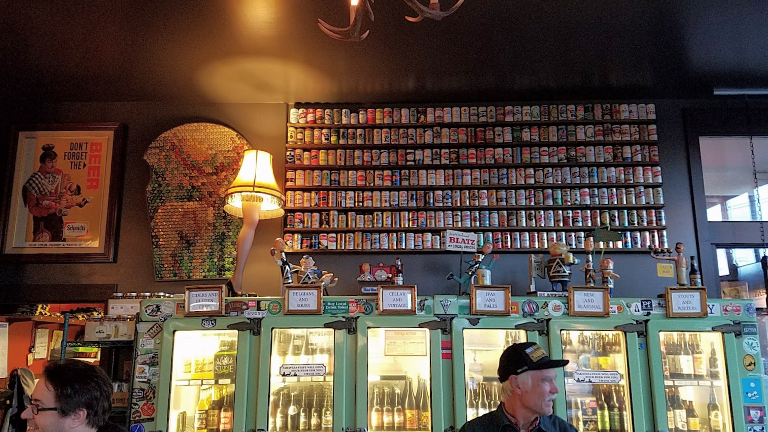 When you walk through that door of Saraveza, you immediately feel a bit like you're in a beer museum with all the retro beer paraphernalia all along the walls and the brightly lit coolers of their literally hundreds of beer by the bottle in addition to their 10 rotating taps