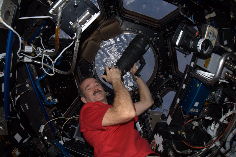 Photo: Photographing Earth - in the Cupola with the big lens.