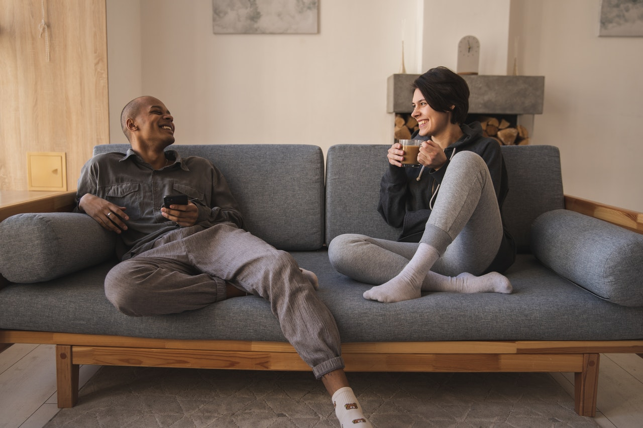 couple laughing on an at home date