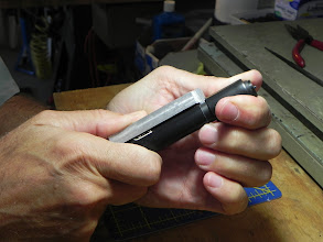 Photo: Once the whistle has a labium, I insert the fipple block and slide the mouthpiece over the head joint using a shop-made gage to ensure they are at the same position as the hundreds that came before.