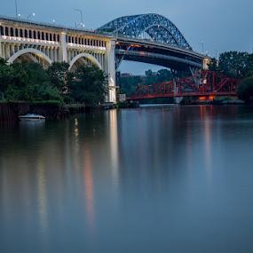 Detroit Superior Bridge by David Pilasky - Buildings & Architecture Bridges & Suspended Structures ( water, night photography, blue, cuyahoga river, blue hour, bridges, cleveland flats, river, cleveland )